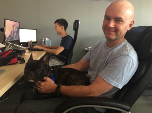 Fridays are Pax days! Here he's helping David code.
